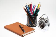 Taccuino con la scatola e l'orologio della penna Immagini Stock Libere da Diritti