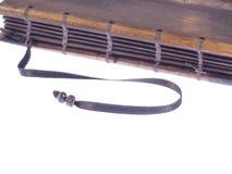 Taccuino d'annata con le coperture di legno su fondo bianco Immagine Stock