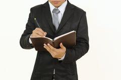 Taccuino di scrittura e della tenuta dell'uomo d'affari isolato su fondo bianco Fotografie Stock
