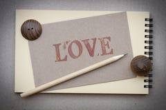 Taccuino e matita con la scheda di amore Fotografia Stock Libera da Diritti