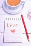 Taccuino e matita rossa Fotografia Stock