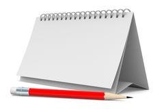 Taccuino e matita su priorità bassa bianca Fotografia Stock