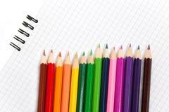 Taccuino e matite Fotografie Stock