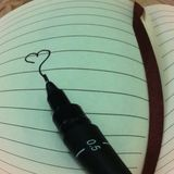 Taccuino e penna Fotografie Stock