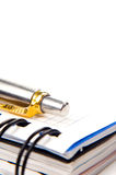 Taccuino e una penna Immagini Stock Libere da Diritti