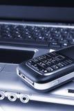 Taccuino, telefono, tecnologia di affari Fotografia Stock