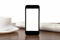 Tach phone with isolated screen on a table at a businessman Royalty Free Stock Photo