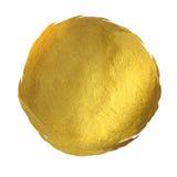 Tache brillante ronde de peinture d'or tirée par la main