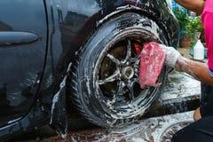 Tache floue d'éclat de roues de voiture de lavage Images libres de droits