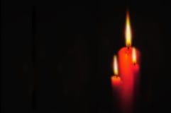 Tache floue de bougie et d'éclairage rouges Photos stock