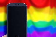 Tache floue de drapeau de Smartphone LGBT Images libres de droits