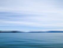 Tache floue de mouvement de mer et de ciel Photographie stock libre de droits