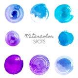 Taches d'aquarelle dans différentes nuances de bleu illustration de vecteur