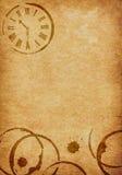 Taches de café et fond de parchemin de vélin d'horloge Photographie stock libre de droits