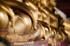 Taches floues de statue de main et de Bouddha de foyer Photos libres de droits