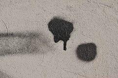 Taches noires sur le mur Photographie stock