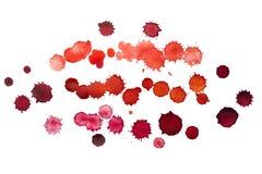 Taches rouges de peinture d'aquarelle Photo stock