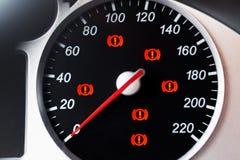 Tachimetro dell'automobile con l'indicatore e le luci d'avvertimento Immagini Stock