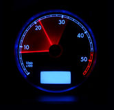 Tachometer. In blue and red colors on black background Royalty Free Stock Images