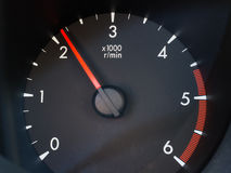 Tachometer. Black car tachometer with white numbers on black background Stock Photos