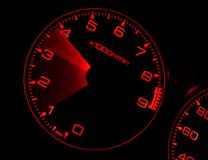 Tachometer. Revving in performance car Royalty Free Stock Photography