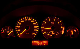Tachometer of a car. A lit tachometer in the night stock photography