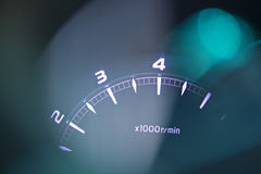 Tachometer and flare light. Royalty Free Stock Photos