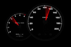 Tachometer gauge. A black tachometer showing the acceleration of a car Royalty Free Stock Photography