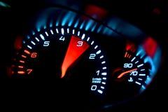 Tachometer gauge. Glow on instrument panel Royalty Free Stock Photos