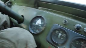 Tachometer in old car. Dashboard on a retro car. Military car. Old pickup truck driving on rough roads stock video footage