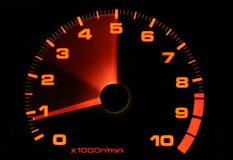 Tachometer revving up. This is a tachometer from showing increasing RPM. This indicates acceleration or speed stock photo