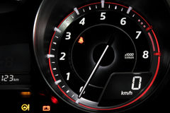 Tachometer showing zero revolutions per minute on the car dashboard Stock Photos