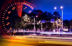 Tachometer/traffic montage. A Digital montage of busy night traffic and a revving tachometer. Portrays the nervous nature of traffic, speed and stress Stock Images