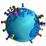 Tachuelas del mundo en globo de la tierra Fotografía de archivo libre de regalías