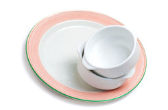 Tack of empty bowls on a plate Stock Photography