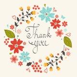Tacka dig att card med den blom- kransen Arkivbild