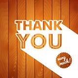 Tacka dig att card med typografi på en träbakgrund. stock illustrationer