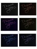 Tacka dig att stava i svart bräde Arkivbild