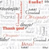 Tacka dig i olika språkord, etiketter Royaltyfri Fotografi