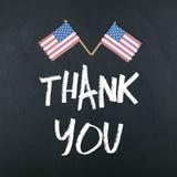 Tacka dig med amerikanska flaggan royaltyfria foton