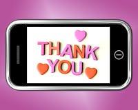 Tacka dig och hjärtameddelandet som tack som överförs på mobil Arkivbild