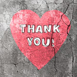 Tacka dig ord på konkret textur vektor Arkivfoton