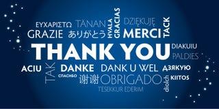 Tacka dig som är flerspråkig, blått Royaltyfri Bild