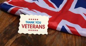 Tacka dig veteranhälsningkortet för flagga för UK-minnedag arkivbild