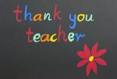 tackar den röda lärare för blomman dig Royaltyfri Bild