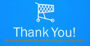 tackar det återgång shoppingtecknet för vagnen dig Royaltyfri Foto