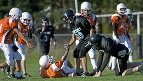After the tackle stock photos