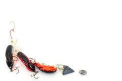 Tackle background. Fishing tackle assorted background bottom left corner isolated on white Stock Photo