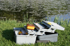Tackle box. Open tackle box on the bank of a pond stock images