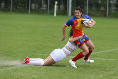 Tackle during female rugby game Royalty Free Stock Photo
